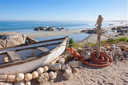 simsearch:400-04638538,k - A traditional fishing boat on the beach at Paternoster, Western Cape, South Africa Stock Photo - Premium Royalty-Free, Code: 682-05977481