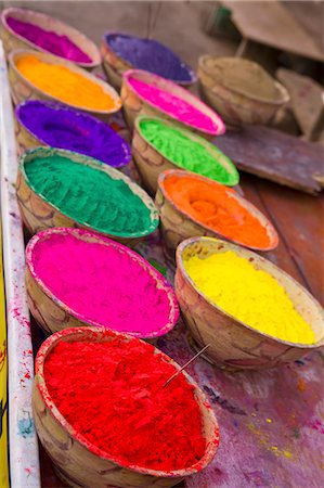 Collection of bright coloured powders for use in the making of Bindi's, taken at stall in Pushkar, Rajasthan, India Stock Photo - Premium Royalty-Free, Code: 682-06374019