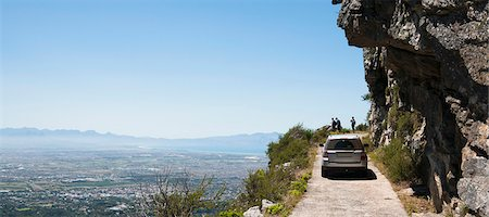 remote car - Vehicle on mountain track with people looking at view of city below, Table Mountain National Park, Cape Town, Western Cape, South Africa Stock Photo - Premium Royalty-Free, Code: 682-06374060