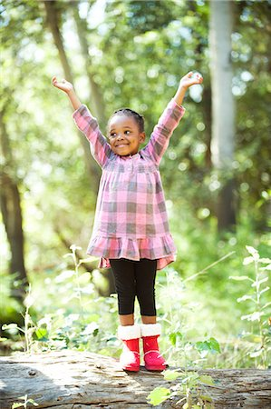portrait looking away - Girl raising arms and standing on log, Johannesburg, South Africa Stock Photo - Premium Royalty-Free, Code: 682-06374402