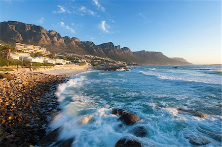 The Twelve Apostles, an extention of the Table Mountain range overlooks the white sandy beaches of camps Bay, Cape Town, Western Cape, South Africa Stock Photo - Premium Royalty-Free, Code: 682-06373948