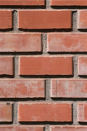 Close-up front view of a red face brick wall showing a stretcher bond brickwork pattern, Cusco, Peru. Stock Photo - Premium Royalty-Free, Code: 682-07281296