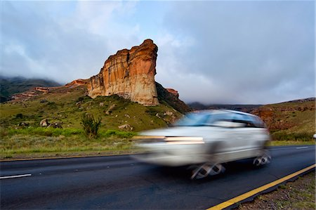 Car in motion in front of iconic Brandwag Buttress in Golden Gate Highlands National Park, Free State Province, South Africa Stock Photo - Premium Royalty-Free, Code: 682-07281368