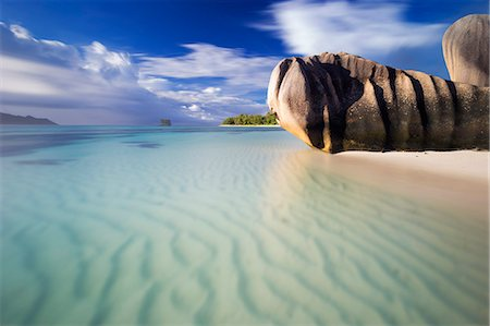 seychelles - Wide angle long exposure view of rippled sands, turquoise water and the iconic granite rocks of Anse Source d'Argent beach. La Digue island, Seychelles Stock Photo - Premium Royalty-Free, Code: 682-07281609