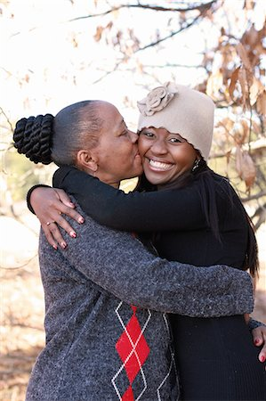 African mother kissing er young adult daughter on the cheek, Johannesburg, South Africa Stock Photo - Premium Royalty-Free, Code: 682-07281697