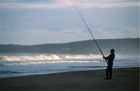 Fisherman on Beach Stock Photo - Premium Royalty-Free, Code: 682-02894452