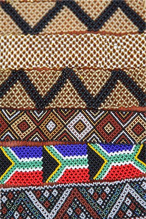 Dispaly of Rows of African Traditional Beaded Wristbands Including the South African Flag Stock Photo - Premium Royalty-Free, Code: 682-02894986