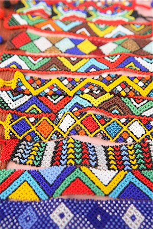 Dispaly of Brightly Coloured African Traditional Beaded Wristbands Stock Photo - Premium Royalty-Free, Code: 682-02894983