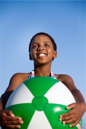 preteen  smile  one  alone - Young girl smiling holding large beach ball, KwaZulu Natal Province, South Africa Stock Photo - Premium Royalty-Free, Code: 682-02891041