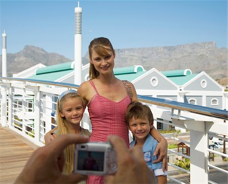 Mother and children having their picture taken with Table Mountain in background, Cape Town, Western Cape Province, South Africa Stock Photo - Premium Royalty-Free, Code: 682-02891277