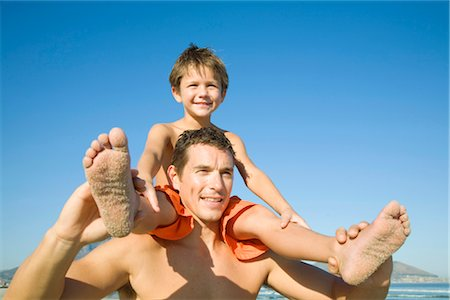 Young boy on father's shoulders in Cape Town, Western Cape Province, South Africa Stock Photo - Premium Royalty-Free, Code: 682-02891289