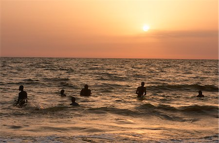 Swimmers Playing in the Surf at Sunset Stock Photo - Premium Royalty-Free, Code: 682-02892412