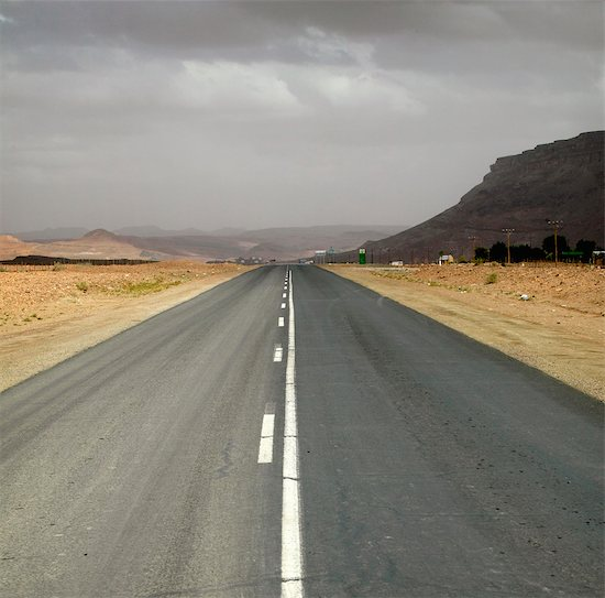 Dual Tar Road Going Through Arid Area on an Overcast Day Stock Photo - Premium Royalty-Free, Image code: 682-02892787