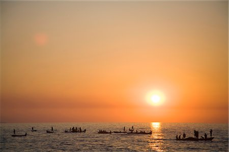 Local Zambian Fishermen in 'Plank' Boats at Sunset Stock Photo - Premium Royalty-Free, Code: 682-02893176