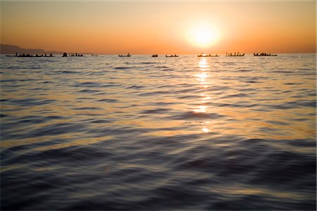 Local Zambian Fishermen in 'Plank' Boats at Sunset Stock Photo - Premium Royalty-Free, Code: 682-02893182