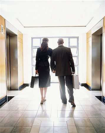 African Businessman and Woman - Rear View Stock Photo - Premium Royalty-Free, Code: 682-02893539