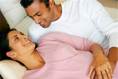 pregnant couple couch - Portrait of a Pregnant Indian Couple Stock Photo - Premium Royalty-Free, Code: 682-02893617
