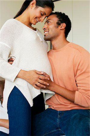 pregnant couple couch - Portrait of a Pregnant Indian Couple Stock Photo - Premium Royalty-Free, Code: 682-02893618