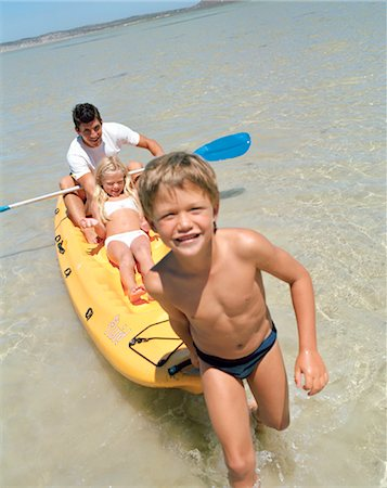 Father with his Children in a Canoe in the Sea Stock Photo - Premium Royalty-Free, Code: 682-02893671