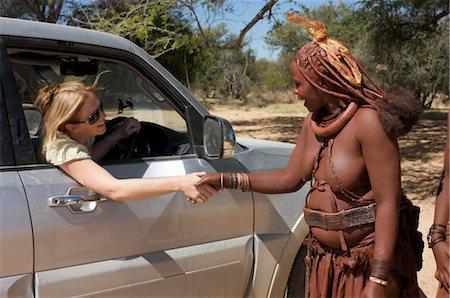 Close up of women greeting each other, Epupa Falls area, Kaokoland, Namibia Stock Photo - Premium Royalty-Free, Code: 682-03285688