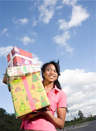 Woman holding Christmas gifts, KwaZulu Natal Province, South Africa Stock Photo - Premium Royalty-Free, Code: 682-03451822
