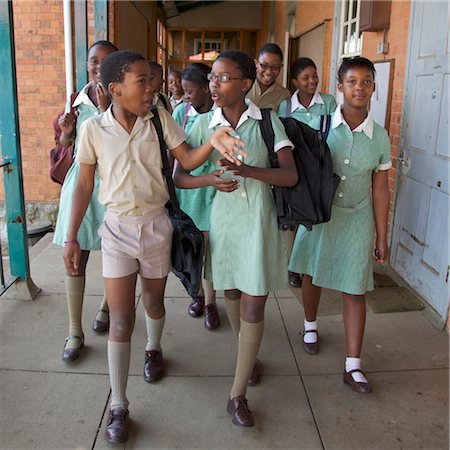 school girl uniforms - Group of schoolchildren walk together along the corridor, KwaZulu Natal Province, South Africa Stock Photo - Premium Royalty-Free, Code: 682-03643835