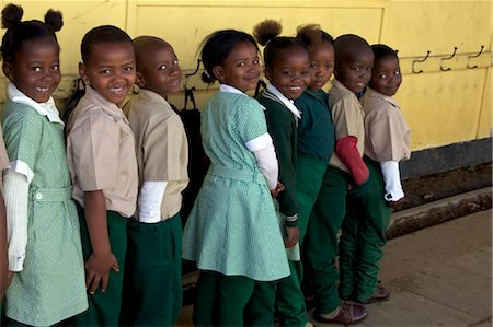school girl uniforms - Group of schoolchildren standing in line outside their classroom, KwaZulu Natal Province, South Africa Stock Photo - Premium Royalty-Free, Code: 682-03643877