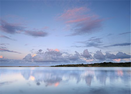 Reflected clouds in shoreline estuary system, St Lucia, Kwazulu-Natal, South Africa Stock Photo - Premium Royalty-Free, Code: 682-03797866
