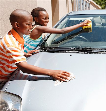 Young boy and girl cleaning car, Johannesburg, South Africa Stock Photo - Premium Royalty-Free, Code: 682-03797951