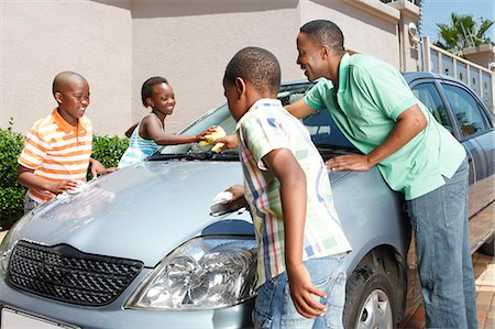 Family cleaning car, Johannesburg, South Africa Stock Photo - Premium Royalty-Free, Code: 682-03797952