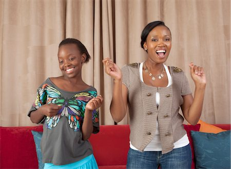 preteen dancing - Woman and girl dancing in lounge, Johannesburg, South Africa Stock Photo - Premium Royalty-Free, Code: 682-03797984