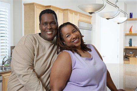 Couple in kitchen, portrait Stock Photo - Premium Royalty-Free, Code: 694-03327423