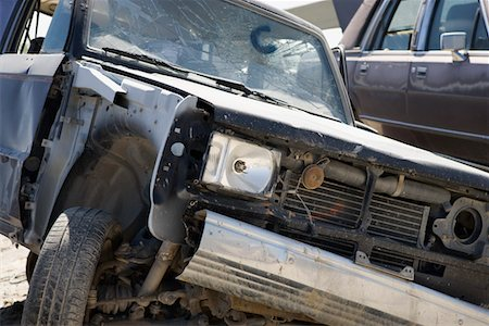 Damaged car in junkyard Stock Photo - Premium Royalty-Free, Code: 694-03328696