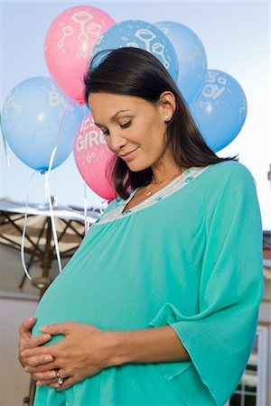pregnant low angle - Pregnant Woman standing outside at a Baby Shower Stock Photo - Premium Royalty-Free, Code: 694-03322295