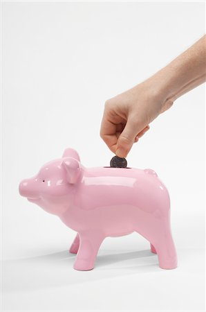 seamless - Hand Putting Money in Piggy Bank Stock Photo - Premium Royalty-Free, Code: 694-03331483