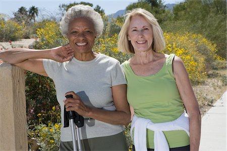 Senior women stand with walking poles Stock Photo - Premium Royalty-Free, Code: 694-03332062