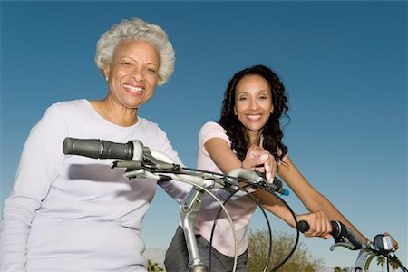 Mother and daughter sit on mountain bikes Stock Photo - Premium Royalty-Free, Code: 694-03332084