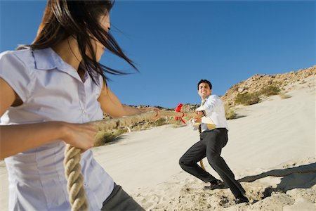 Two Business People Playing Tug of war in the Desert Stock Photo - Premium Royalty-Free, Code: 694-03332431