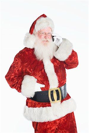 Santa Claus on mobile phone Stock Photo - Premium Royalty-Free, Code: 694-03332467