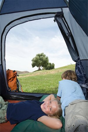 Brother and sister lie in a tent Stock Photo - Premium Royalty-Free, Code: 694-03440989