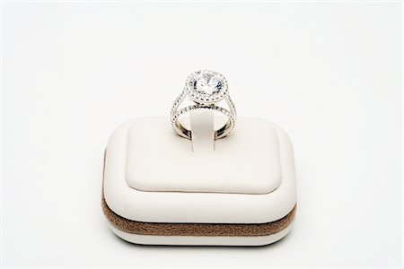 expensive jewelry - Platinum ring with 5 carat centre diamond surrounded by full cut 0.80 carat diamonds Stock Photo - Premium Royalty-Free, Code: 694-03783247