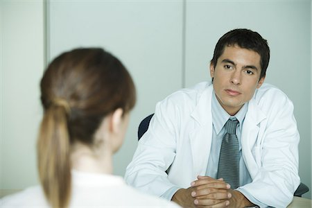 Doctor sitting across from female patient Stock Photo - Premium Royalty-Free, Code: 695-05765413