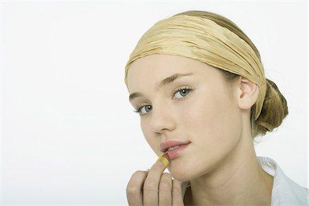 female silhouette head and hand - Teenage girl applying lipstick Stock Photo - Premium Royalty-Free, Code: 695-05765509