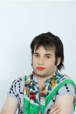 Young man wearing lipstick and scarf around neck, portrait Stock Photo - Premium Royalty-Free, Code: 695-05765904
