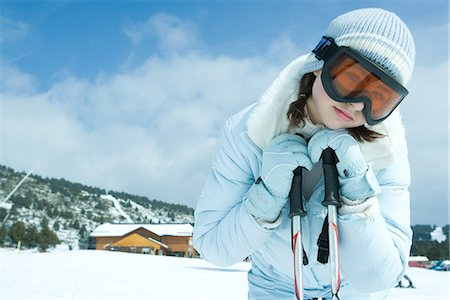 Teen girl leaning on ski sticks, in snowy landscape, portrait Stock Photo - Premium Royalty-Free, Code: 695-05766631