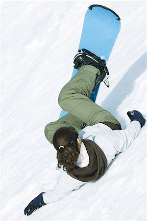 Young snowboarder falling down ski slope, rear view Stock Photo - Premium Royalty-Free, Code: 695-05766694