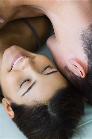 Man lying on top of woman, woman smiling, cropped view, close-up Stock Photo - Premium Royalty-Free, Code: 695-05767104