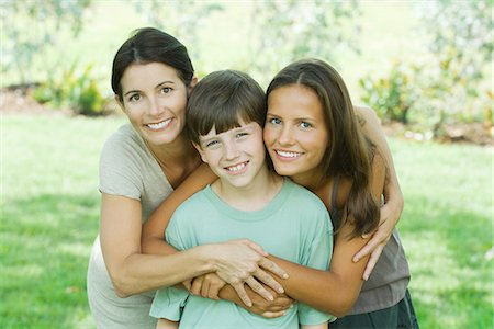 Mother with son and teen daughter, smiling at camera, portrait Stock Photo - Premium Royalty-Free, Code: 695-05768566