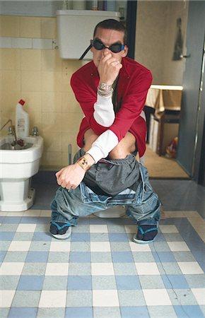smelly - Man using toilet, pinching nose Stock Photo - Premium Royalty-Free, Code: 695-05769367