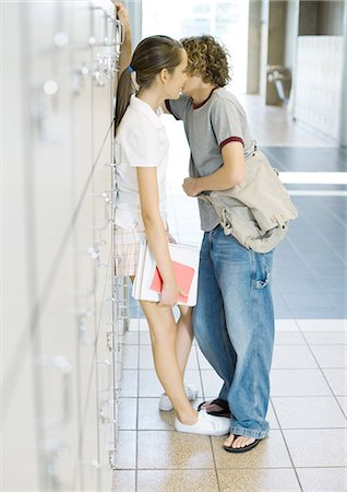 preteen kissing - Teen couple leaning against school lockers Stock Photo - Premium Royalty-Free, Code: 695-05763377